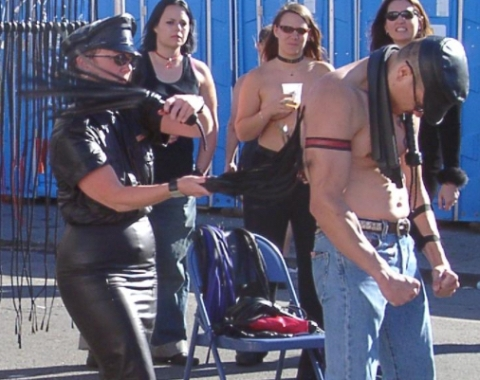 Flogging Demonstration at Folsom Street Fair 2004. Image: Pretzelpaws. Wikipedia Creative Commons.
