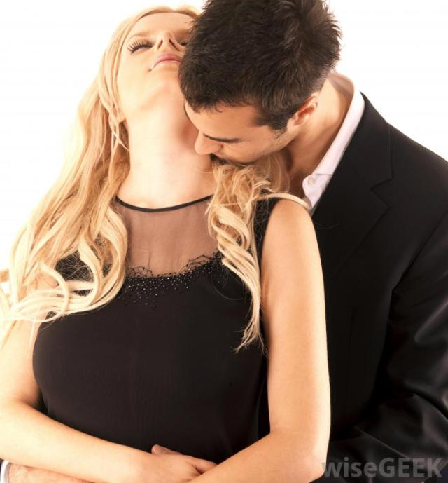 man-kissing-womans-neck